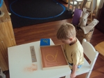 Child learning to write with Montessori